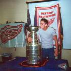 """Thomas Richter, from Germany, got the opportunity of a lifetime when an officer allowed this photo-op in a Police Station in Allen Park (near Detroit), where the Detroit Red Wings' Cup was being temporarily held. """"When I show the picture on an US Air Force Base near Ramstein in Germany they almost can't believe that I got to touch the holy grail."""""""