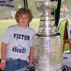 """""""Here are pictures of my son, Matthew Ewanow from Victor, New York with the Stanley Cup. The Cup was brought to the Clifton Springs Country Club on August 22, 2007 courtesy of Tim Clark, head trainer of the NHL champion Anaheim Ducks."""" -- Nanette Ewanow"""