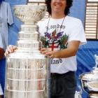 ''The summer of 1990:  John Muckler, coach of the Cup winning Oilers took the Cup to his home state of Rhode Island, where he put it and other trophies on display at a local outdoor street-hockey rink.  Although they beat 'our' Bruins for the Championship it was still a thrill to touch Lord Stanley's Cup.  I had just returned from London where I was able to touch the Rosetta Stone in the British Museum, but I doubt I had the same smile!'' -- Fred Deusch