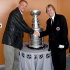 """Guy Wassertzug got his chance to see the Cup at the Washington Capitals' practice facility in March of 2007. Pictured with him is the """"keeper of the Cup,"""" -- Phil Pritchard."""