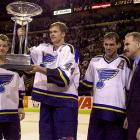 Brett Hull's best years (1990-92) gave way to a formidable team that boasted the superb backline duo of Chris Pronger (44) and Al MacInnis (left), plus center Pierre Turgeon (middle-right) and goaltender Grant Fuhr.  Under head coach Joel Quenneville (right), the Blues won the Presidents' Trophy in 1999-2000, only to suffer a galling seven-game playoff ouster by the lowly San Jose Sharks in the first round. The following season, they advanced to the Conference final only to be buried by Patrick Roy's Colorado Avalanche in five games.