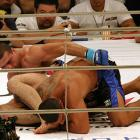 """With a historical feud between the two camps, newbies Ricardo Arona (bottom) of BTT and Mauricio """"Shogun"""" Rua of Chute Boxe turned up the heat with their 2005 PRIDE fight as Rua used Arona's signature skill of finishing an opponent on the ground to beat his BTT rival by TKO."""