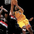 "Shaquille O'Neal and Kobe Bryant led the Lakers back from a 15-point fourth-quarter deficit to topple the Blazers 89-84 in Los Angeles en route to their first NBA crown under coach Phil Jackson. ""We realize we sort of made cowards of ourselves in the fourth quarter,"" Portland's Scottie Pippen said after the game."