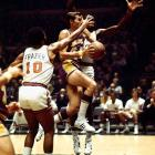 After hobbling off the court early in Game 5 with a torn thigh muscle, Willis Reed made a surprising and triumphant return moments before tip-off for the deciding game. Buoyed by his presence -- and his scoring the first two baskets of the game -- the Knicks won the title 113-99 behind Walt Frazier's 36 points and 19 assists.