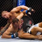 Mendes' survival skills didn't last long after he recovered from a couple of kicks that sent him to the canvas. The undefeated Silva (top) extended his record to 13-0 with strikes on the ground to defeat Mendes by TKO in the first round.