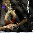 Despite his opponent's efforts to get out if it, Yoshida (not pictured) submitted Koppenhaver (left) with an Anaconda choke in the first round.