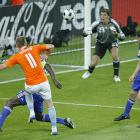 Less than a minute after Thierry Henry scored to pull France within 2-1, Robben wrested the momentum back for the Dutch with an artful strike. The Real Madrid winger darted around a pair of French defenders and fired a shot toward the net from an impossible angle, beating Coupet on his near post and preening for the Dutch supporters.
