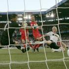 After Philipp Lahm, Michael Ballack and Lukas Podolski negotiated the Germans downfield with some deft passing, Schweinsteiger opened the scoring against Portugal with a sliding finish in the 22nd minute of their soggy quarterfinal clash at St. Jakob-Park in Basel.