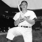 In a 18-7 loss to the Tigers, 18-year old rookie third baseman Harmon Killebrew hits his first major league home run off Billy Hoeft.