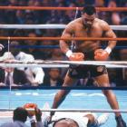 Mike Tyson knocks out Michael Spink in 91 seconds to maintain the IBF/WBA/WBC Heavyweight titles.