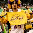 A hearty Lakers fan proudly shows his true colors amidst a sea of green-and-white Celtics supporters.