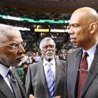 Julius Erving (L-R), Bill Russell and Kareem Abdul-Jabaar converse before Game 1 at Boston. Collectively, the Hall of Fame trio has accounted for 18 NBA championships.