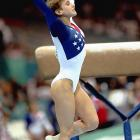 The U.S. Women's gymnastics team needed Strug to earn a 9.5 or better on her vault to seal the gold medal, but she fell on her first attempt, injuring her ankle. Her second pass, though, provided the defining image of the 1996 Atlanta Olympics: She landed her vault on one leg and earned a 9.712 -- good enough to clinch the gold medal -- before crumbling to the ground in pain.