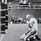 The iconic photo of him kneeling came during a 1964 game against the Pittsburgh Steelers after throwing an interception that was returned for a TD. He suffered a concussion and a cracked sternum on the play but would go on to finish his last NFL season despite the Giants 2-10-2 record.