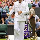 Perhaps a bit over-dressed for the occasion, Roger Federer reclaimed his title as Wimbledon champion in 2009.
