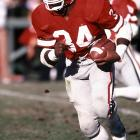 One of the greatest college football players in history, Walker set 11 NCAA and 41 school records during his time in Athens. He rushed for 5,259 yards as a Bulldog, the most ever by an NCAA player in a three-year span. Walker was also the 1982 Heisman Trophy winner. Off the gridiron, Walker was a two-time All-America on Georgia's track team.
