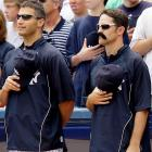 """The Yankees really enjoyed promoting their """"Jason Giambi Mustache Day"""" on Wednesday, but someone needs to point out that the mustaches they distributed -- worn here by Mike Mussina -- look nothing like Giambi's."""