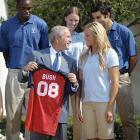 President Bush definitely looks like a Jennie Finch fan.