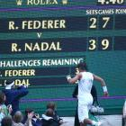 Newly minted Wimbledon champion Rafael Nadal passes the giant scoreboard at Centre Court -- with hopes of finding his parents in the stands.
