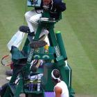 The chair umpire from Sunday's final converses with Rafael Nadal during a break in the third set.