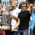 Ron Jaworski and Jon Bon Jovi, co-owners of the Arena Football League champion Philadelphia Soul, hold up the team's trophy during a celebration in Philly on Thursday.  It may not be an NFL, MLB, NHL or NBA title, but at least it's something.