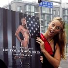 Amanda Beard shows off her new PETA ad. She certainly does look comfortable in her own skin.