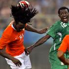 You can't blame Nigeria's Ebenezer Ajilore (right) for freaking out when that soccer ball popped out of Evander Sno's hair.