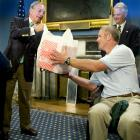 New York City's Mayor Michael Bloomberg tries to follow the adage that the way to a man's heart is through his stomach, as he presents Brett Favre with a bag of Junior's cheesecakes.