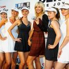 Maria Sharapova, surrounded by look-alikes, holds a $10,000 diamond studded Canon camera.