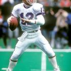 USFL star Jim Kelly signs with the Buffalo Bills for $75 million over five years.