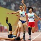Marie-Amelie le Fur of France steps on the face of April Holmes of the United States after she fell during the final of the 200.