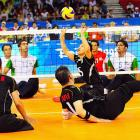 Japan's Nakayama Kaname sets against Iran in the sitting volleyball competition.