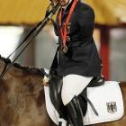 Bronze medalist Bettina Eistel of German celebrates after winning the Equestrian Individual Dressage Championship Test Grade III.