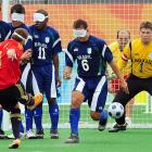 Jesus Antonio Martin (9) of Spain shoots from a free-kick against Brazil. Spain lost 1-0 in a sport in which each team fields four blind players and one sighted or visually impaired goalkeeper.