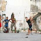 A street baseball game in Old Havana on Wednesday afternoon.