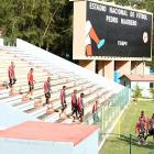 The Cuban national soccer team enters Estadio Pedro Marrero for their session with the international media on Wednesday.