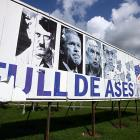 "One of the first things the U.S. soccer team saw on the road leaving the Havana airport on Thursday was a giant billboard featuring President George W. Bush next to Adolf Hitler, the late Cuban-exile leader Jorge Mas Canosa and Orlando Bosch. ""Full De Asesinos"" has a double meaning: ""Ases"" means *Aces* (note the playing card theme, an echo of the U.S.-produced playing cards showing ex-Iraqi leaders), while ""Asesinos"" means *Murderers*."