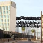 The U.S. Interests Section building (left), operated by the Swiss, is the closest thing in Havana to a U.S. embassy. When the U.S. started posting electronic sign-board messages to counter Castro's message a few years ago, the Cuban government responded by erecting 138 flags in front of the building to block the view of the sign-board messages. Immature on both sides? Yes. The black flags are a little creepy in person, too.