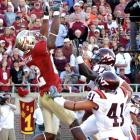Leave it to the enigmatic Seminoles to register only 248 yards of total offense ... and yet score 30 points, while winning in going-away fashion. Receiver Taiwan Easterling had the play of the day, hauling in this acrobatic 4-yard scoring catch.
