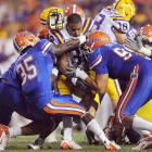 LSU's Charles Scott was held to just 35 yards on the ground as the Tigers suffered their most lopsided loss since 2002. Tim Tebow threw for three touchdowns and ran for another as the Gators thumped the defending national champions.