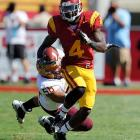 USC running back Joe McNight helped his team win against Arizona State by running 143 yards. The Trojans also blocked two field goal attempts and returned an interception for a touchdown.