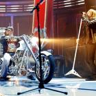 The Red Wings' Darren McCarty gives the Stanley Cup a ride as Def Leppard performs during NHL Face-Off Rocks at the Fox Theatre on Thursday.