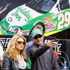 """Jessica Simpson is taking her shift to """"country singer"""" seriously. She hung out with driver Scott Wimmer at Lowe's Motor Speedway in Concord, N.C., on Friday. Simpson will perform a concert and sing the national anthem before Saturday's NASCAR Sprint Cup Bank of America 500."""