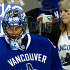 Canucks goaltender Roberto Luongo was way too focused to turn around and give that fan a smile during Thursday night's game against the Flames.