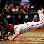 Not only was Shane Victorino tagged out on this play in Game 1 of the World Series, but also he got his hand stepped on.