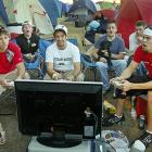 Texas Tech students (from left to right) Will McKenzie, Bryan Boyd and Will Kelly played Xbox with friends outside Jones AT&T Stadium on Thursday. Students began camping outside the stadium Tuesday afternoon in hopes of being one of the 12,000  allowed in the stadium for Saturday's game against No. 1 Texas.
