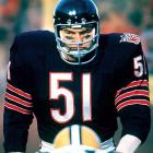 One of the most feared players in NFL History, Dick Butkus was an unmistakable presence on the football field, earning eight Pro Bowl nods and six First Team All-Pro selections. True to form, he maintained that personality as an actor.  Though he appeared in various television shows after retirement, his acting career is probably defined by his portrayal of himself in Brian's Song (1971).