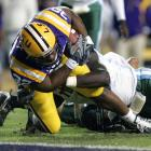 Charles Scott rushed 12 times for 114 yards and this 6-yard touchdown to lead LSU to an easy win. Tulane finished with 10 first downs and 158 yards of total offense.