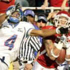 Arkansas jumped out to a 17-0 lead but had to hold on to end Tulsa's dream of an unbeaten season. Cornerback Isaac Madison (shown at right) intercepted this fourth-quarter pass to help shut down the Golden Hurricane, who had been averaging 57 points per game.