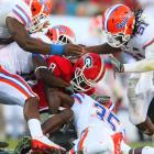 """Florida had to wait a year to avenge the infamous """"bulldog stomp,"""" but got its payback in a huge way. Tim Tebow threw for two scores and ran for three more as the Gators beat the Bulldogs for the 16th time in the last 19 series meetings."""